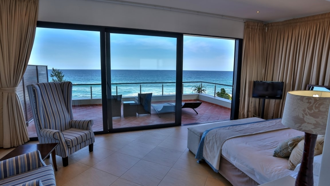 Canelands - slaapkamer met zeezicht