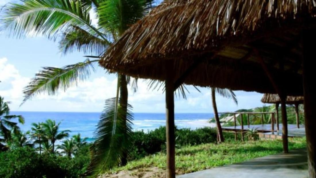 Jeffs Palm Resort - Terras met uitzicht over zee