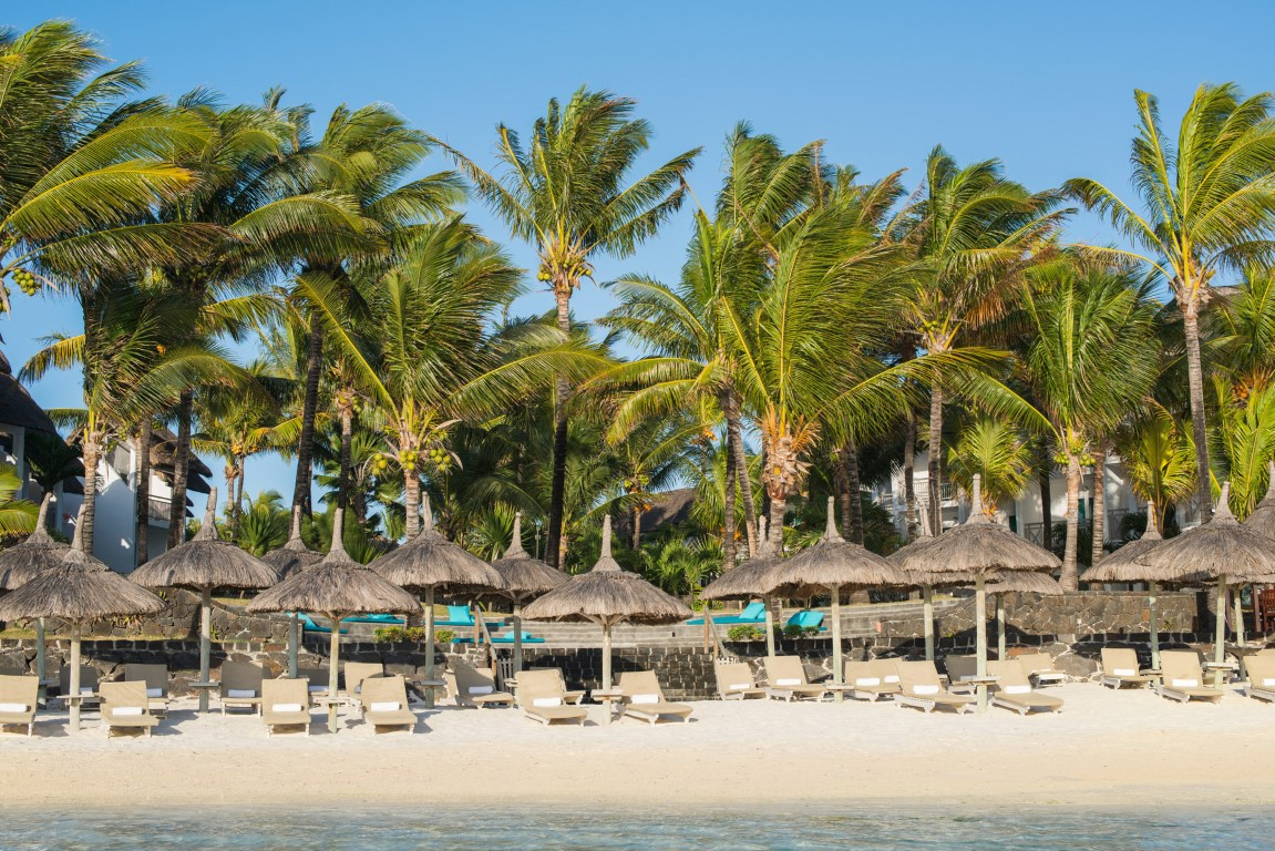 Palmar Beach - Strand met ligbedden en parasols van riet