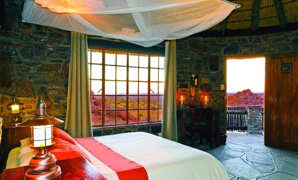 Canyon Lodge - Slaapkamer met uitzicht op de bergen